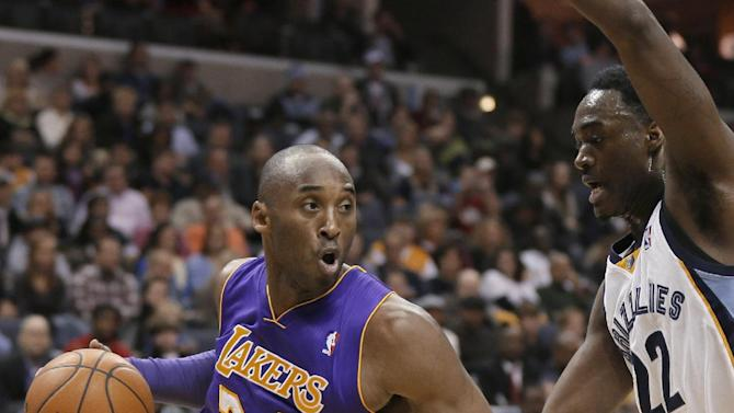 Los Angeles Lakers' Kobe Bryant (24) dribbles around Memphis Grizzlies' Jamaal Franklin (22) during the first half of an NBA basketball game in Memphis, Tenn., Tuesday, Dec. 17, 2013