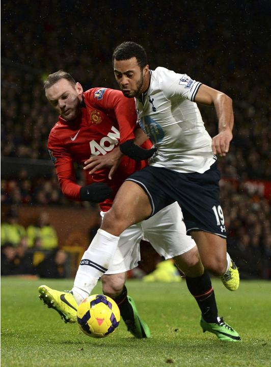 Manchester United's Rooney is challenged by Tottenham Hotspur's Dembele during their English Premier League soccer match in Manchester