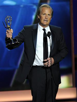 """Jeff Daniels accepts the award for outstanding lead actor in a drama series for his role on """"The Newsroom"""" at the 65th Primetime Emmy Awards at Nokia Theatre on Sunday Sept. 22, 2013, in Los Angeles. (Photo by Chris Pizzello/Invision/AP)"""