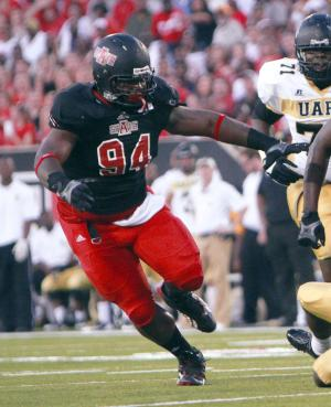 In this photo taken on Aug. 31, 2013, and released by Arkansas State, Arkansas State defensive lineman Markel Owens rushing against Arkansas-Little Rock during an NCAA college football game in Jonesboro, Ark. Authorities said Thursday, Jan. 16, 214, that Owens was one of two men shot to death during a home invasion robbery in Jackson, Tenn., Wednesday night. (AP Photo/Arkansas State)