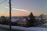In this photo provided by E1.ru a meteorite contrail is seen over a vilage of Bolshoe Sidelnikovo 50 km of Chelyabinsk on Friday, Feb. 15, 2013. A meteor streaked across the sky of Russia's Ural Mountains on Friday morning, causing sharp explosions and reportedly injuring around 100 people, including many hurt by broken glass. (AP Photo/ Nadezhda Luchinina, E1.ru)