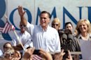 Republican presidential candidate, former Massachusetts Gov. Mitt Romney waves to the crowd during a campaign stop at Bavarian Inn Lodge on Tuesday, June 19, 2012 in Frankenmuth, Mich. (AP Photo/The Saginaw News, Jeff Schrier)