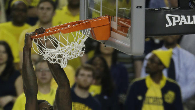 Louisville forward Montrezl Harrell (24) dunks the ball against Michigan during the first half of the NCAA Final Four tournament college basketball championship game Monday, April 8, 2013, in Atlanta. (AP Photo/Chris O'Meara)