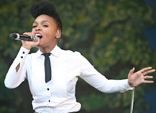 Janelle Monae on stage performing