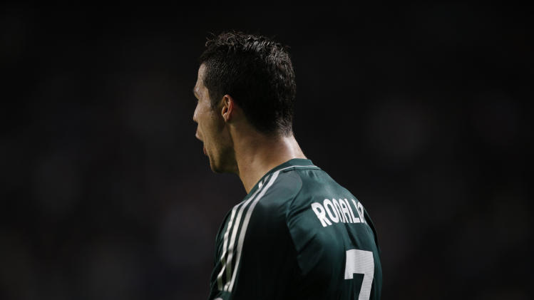 Real Madrid player Cristiano Ronaldo screams after scoring the final goal during the Champions League Group D soccer match against Ajax at ArenA stadium in Amsterdam, Netherlands, Wednesday Oct. 3, 2012. (AP Photo/Peter Dejong)