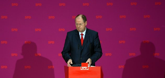 Chancellor Angela Merkel's center-left challenger in next year's German elections Peer Steinbrueck from the Social Democrats says at a news conference in Berlin, Germany, Tuesday, Oct. 30, 2012, he earned some euro 1.25 million (US dollar 1.6 million) over three years giving lectures _ and says he's detailing his earnings as an example to rivals who questioned his credibility. (AP Photo/dapd, Oliver Lang)
