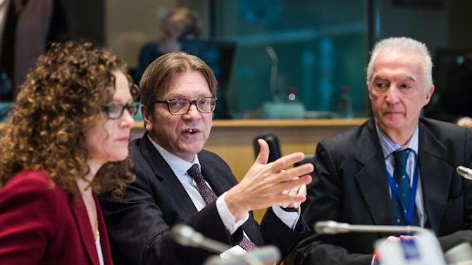 ALDE President Guy Verhofstadt, center, EU Counter-Terrorism chief Gilles de Kerchove, right, and Dutch Member of European Parliament Sophie in 't Veld talk at the start of a meeting of the Alliance of Liberals and Democrats for Europe (ALDE) on a counter-terrorism action plan, at the European Parliament in Brussels on Wednesday, Jan. 28, 2015. (AP Photo/Geert Vanden Wijngaert)