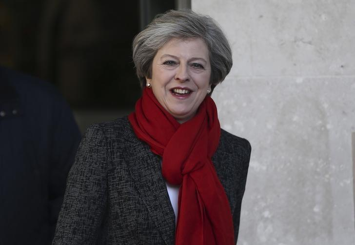 UK's May to defend free trade and Iran deal in talks with Trump