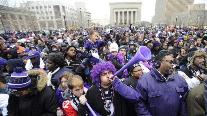 Baltimore Ravens fans blow horns during a victory ceremony at City Hall Tuesday, Feb. 5, 2013 in Baltimore. The Ravens defeated the San Francisco 49ers in NFL football's Super Bowl XLVII 34-31 on Sunday. (AP Photo/Gail Burton)(AP Photo/Gail Burton)