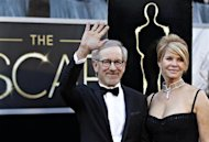 Steven Spielberg, best director nominee for his film &quot;Lincoln&quot;, and his wife Kate Capshaw arrive at the 85th Academy Awards in Hollywood, California February 24, 2013. REUTERS/Lucas Jackson