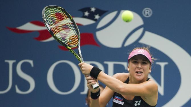 Bencic of Switzerland returns a shot to Williams of the U.S. during their third round match at the U.S. Open Championships tennis tournament in New York