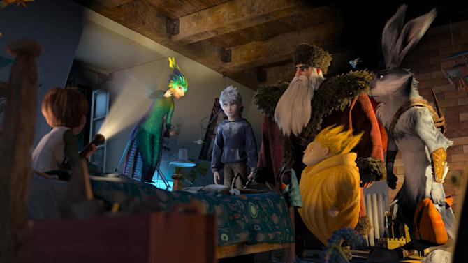 """This film image released by DreamWorks Animation shows the character Jamie, voiced by Dakota Goyo, left, as he awakens to find The Guardians, from second left, Tooth, voiced by Isla Fisher, Jack Frost, voiced by Chris Pine, North, voiced by Alec Baldwin, Sandman, and Bunnymund, voiced by Hugh Jackman in a scene from """"Rise of the Guardians.""""  The 3-D computer-generated fantasy tale is based on William Joyce's book series, """"The Guardians of Childhood."""" (AP Photo/DreamWorks Animation)"""