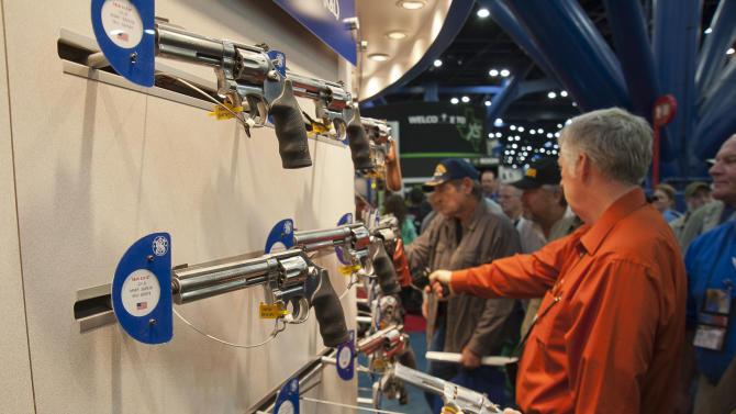Smith and Wesson pistols are on display during the National Rifle Association's annual convention Friday, May 3, 2013 in Houston. (AP Photo/Steve Ueckert)