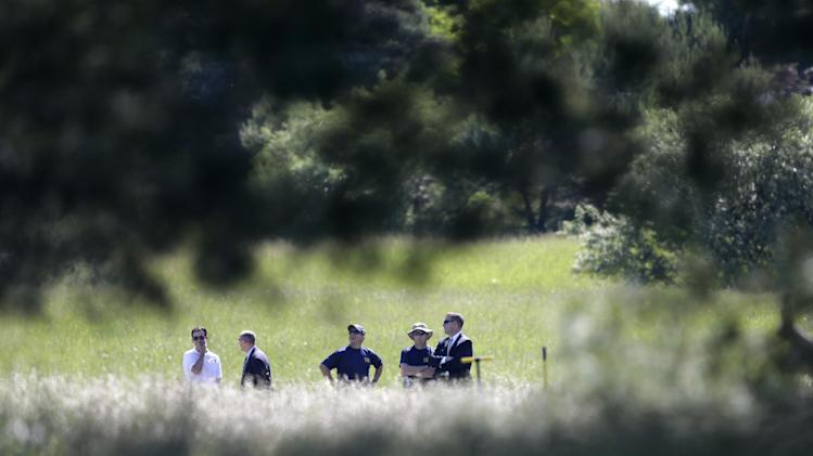 Investigators look over the scene in Oakland Township, Mich., Monday, June 17, 2013, where officials search for the remains of Teamsters union president Jimmy Hoffa who disappeared from a Detroit-area restaurant in 1975. (AP Photo/Carlos Osorio)