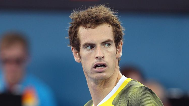 Andy Murray of Britain reacts after winning the first set in his semi final match against Kei Nishikori of Japan during the Brisbane International tennis tournament in Brisbane, Australia, Saturday, Jan. 5, 2013.  (AP Photo/Tertius Pickard).
