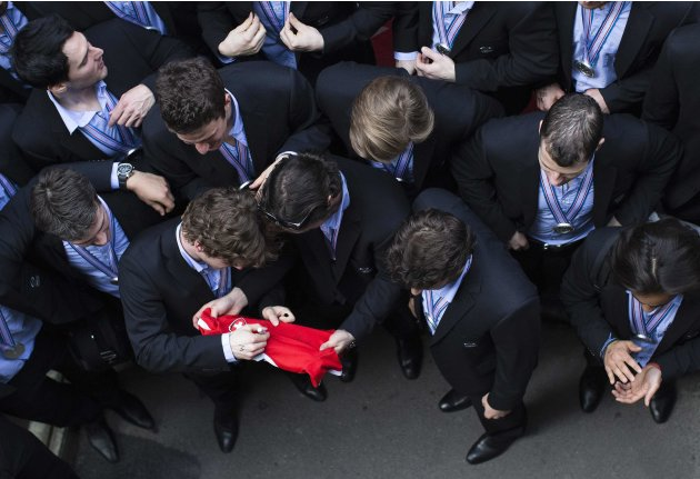 Swiss national ice hockey team players sign autographs on their arrival at Zurich Airport
