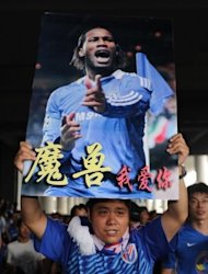 Shanghai Shenhua fans welcomes Didier Drogba as he arrives at Pudong international airport in Shanghai on July 14. Drogba will join French striker Nicolas Anelka, who signed with Shenhua in January on a deal believed to be nearly as high