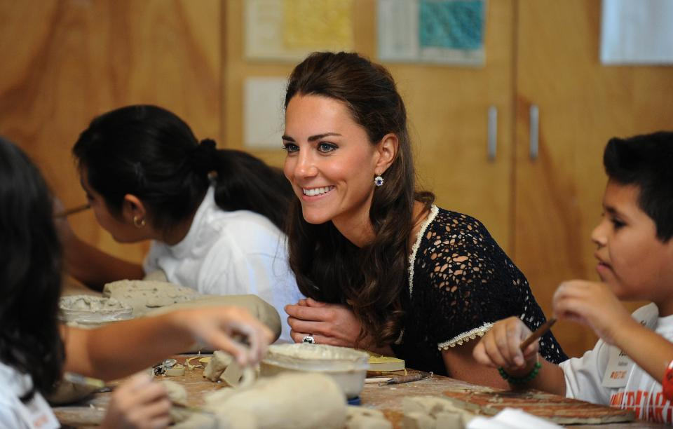 Kate, the Duchess of Cambridge, visits a ceramics class during a tour of the Inner City Arts academy in Los Angeles, on Sunday July 10, 2011, the last day of the royal newlyweds' visit to southern California. (AP Photo/Mike Nelson, Pool)