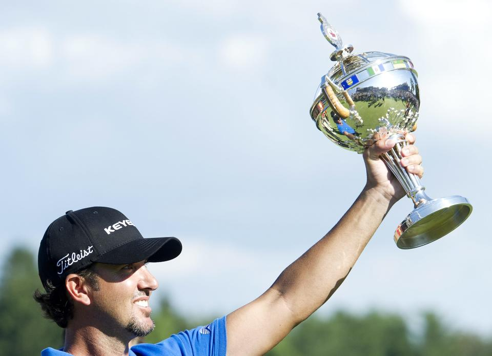 Scott Piercy holds the championship trophy after winning the 2012 Canadian Open at the Hamilton Golf and County Club in Hamilton, Ontario, on Sunday, July 29, 2012. (AP Photo/The Canadian  Press, Nathan Denette)