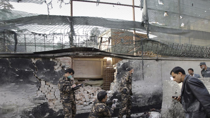Afghan security men inspect the scene of a suicide attack in Kabul, Afghanistan, Wednesday, Nov. 21, 2012. A man wearing a suicide vest blew himself up near a U.S. base in the Afghan capital early Wednesday, killing at least one person in what looked like a thwarted attempt to attack the American base, police said. (AP Photo/Musadeq Sadeq)