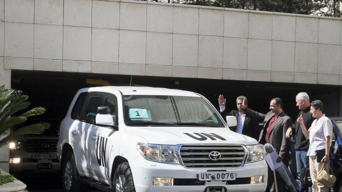 The head of UN inspectors' team, Professor Ake Sellstrom, second right, and Angela Kane, right, the representative on the United Nations for Disarmament Issues, watch as the UN inspectors' team leaves the Four Seasons hotel in Damascus, Syria, August 28, 2013. United Nations Secretary-General Ban Ki-moon pleaded for a diplomatic solution to the Syrian conflict, even as world powers appeared to be moving toward punitive military strikes against President Bashar Assad's regime for what the United States and its allies say was a deadly chemical weapons attack. Syria has denied it was behind the alleged attack. (AP Photo)