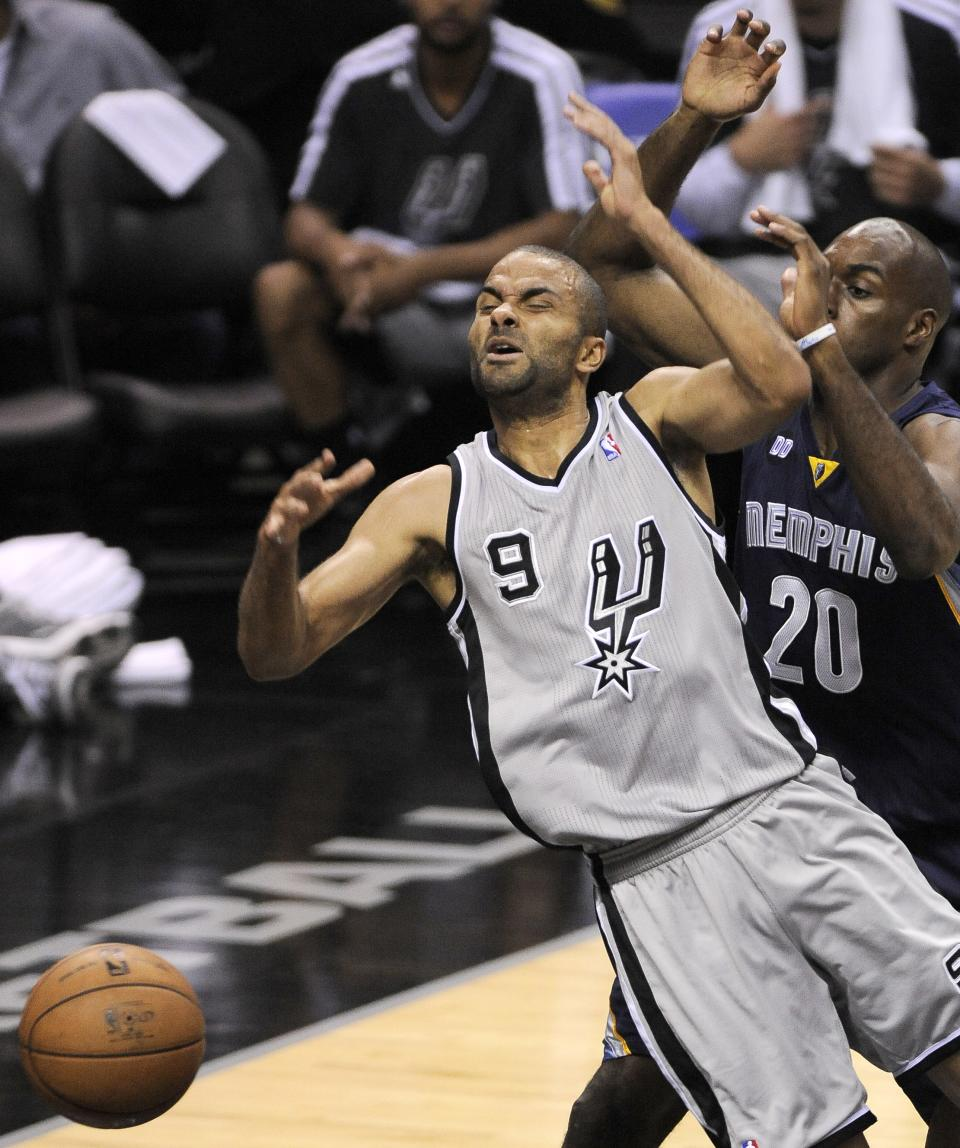 San Antonio Spurs' Tony Parker, left, of France, is fouled as he drives around Memphis Grizzlies' Quincy Pondexter during the first half of Game 1 of the Western Conference final NBA basketball playoff series on Sunday, May 19, 2013, in San Antonio. San Antonio won 105-83. (AP Photo/Darren Abate)
