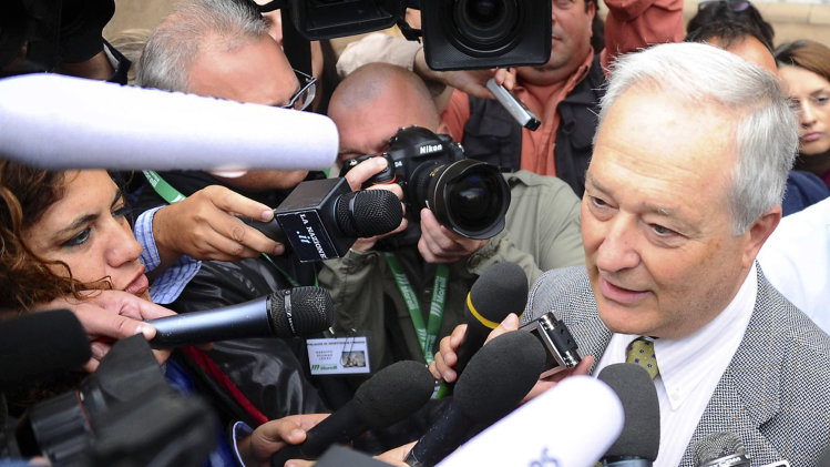 """Francesco Sollecito, father of co-defendant Raffaele Sollecito, talks to reporters as he arrives for the start of U.S. student Amanda Knox's second appeals trial in her British roommate's murder, in Florence, Italy, Monday, Sept. 30, 2013. Italy's highest court ordered a new trial for Knox and her former Italian boyfriend Raffaele Sollecito, overturning their acquittals in the gruesome 2007 slaying of Meredith Kercher with a harsh assessment of an appeals court acquittal in 2011. The Court of Cassation said the acquittal was full of """"deficiencies, contradictions and illogical"""" conclusions. (AP Photo/Francesco Bellini)"""