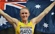 Australia's Sally Pearson celebrates after the women's 100m hurdles final at the athletics event during the London 2012 Olympic Games. Pearson admitted that she felt the pressure to rescue Australia's flagging Olympics campaign when she lined up for her 100m hurdles triumph