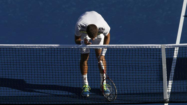 Martin Klizan of Slovakia reacts to a missed point againstTomas Berdych of the Czech Republic during their match at the 2014 U.S. Open tennis tournament in New York