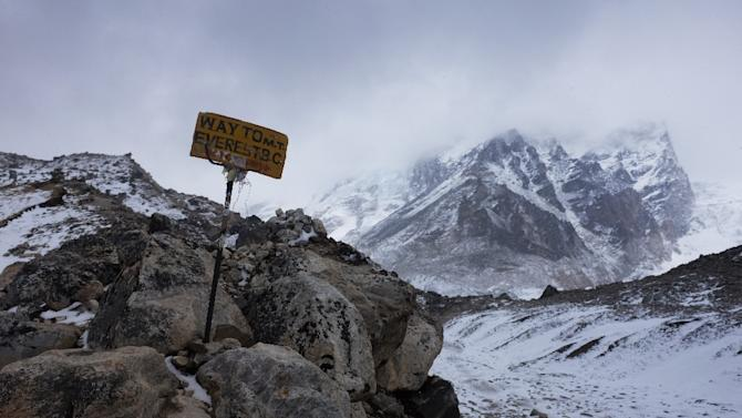 A sign showing the way to Everest Base Camp high in the Khumbu Glacier, seen April 26, 2015, one day after an earthquake-triggered avalanche swept through parts of the base camp