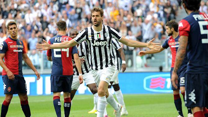 Juventus forward Fernando Llorente, of Spain, celebrates after scoring during a Serie A soccer match between Juventus and Cagliari at the Juventus stadium, in Turin, Italy, Sunday, May 18, 2014. (AP Photo/Massimo Pinca)