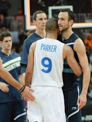 French guard Tony Parker is congratulated by Argentinian guard Manu Ginobili (R) after the Men&#39;s preliminary round group A basketball match of the London 2012 Olympic Games France vs Argentina at the basketball arena in London. France won 71 to 64