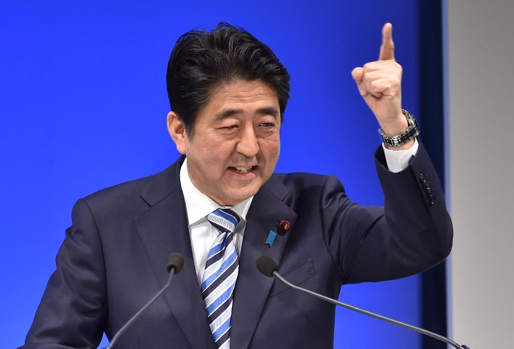Public support for Japan's Abe rebounds after security law: polls