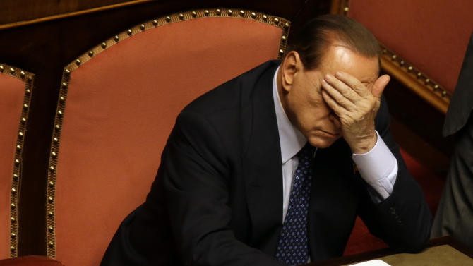 FILE - In This Oct. 2, 2013 file photo, Silvio Berlusconi sits at the Senate in Rome. A Milan appeals court on Saturday, Oct.19, 2013 set Silvio Berlusconi's political ban in his tax fraud conviction at two years. The ex-premier's attorney immediately vowed to take it to a higher court, prolonging the wrangling over the future of the embattled politician who still wields a strong influence on Italy's government. The appellate court was ordered by Italy's highest court to determine the length of the political ban accompanying his tax fraud conviction and four-year jail term after prosecutors conceded sentencing errors in the original five-year ban. (AP Photo/Gregorio Borgia, Files)