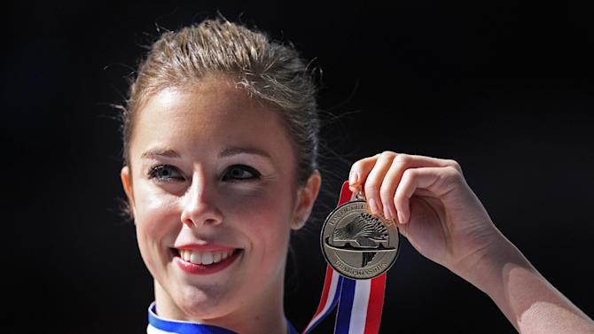 Ashley Wagner poses for photos with her medal after winning the ladies free skate event at the U.S. Figure Skating Championships in San Jose, Calif., Saturday, Jan. 28, 2012. (AP Photo/Marcio Jose Sanchez)