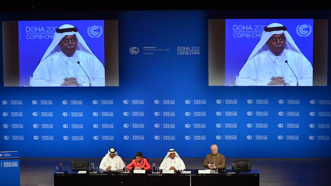 United Nations Convention on Climate Change Executive Secretary Christiana Figueres, second left, speaks during a press conference along side Qatar's Deputy Prime Minister and president of the 18th United Nations Convention on Climate Change, Abdullah bin Hamad Al-Attiyah, second and on screens, right, in Doha, Qatar,Monday, Dec. 3, 2012. (AP Photo/Osama Faisal)