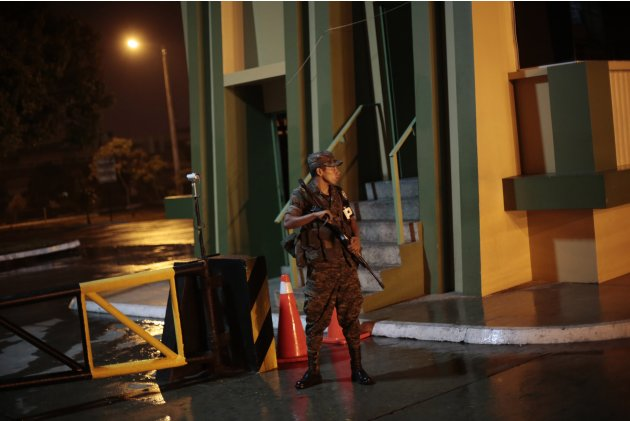 A soldier stands guard at the entrance of the Centro Medico Militar (Military Medical Center), where former Guatemalan dictator Efrain Rios Montt has been undergoing medical treatment since May 13 aft