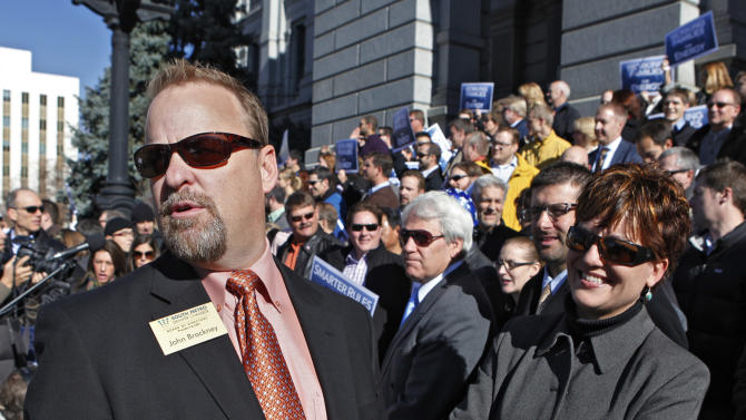 John Brackney, left, President and CEO of the South Metro Chamber of Commerce and Kelly Brough, right, President and CEO of the Denver Metro Chamber of Commerce look over the crowd of supporters during a rally at the Capitol in Denver on Tuesday, Nov. 13, 2012. Brackney and Brough were among the speakers at the rally in support of fracking. (AP Photo/Ed Andrieski)