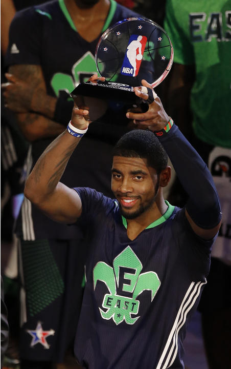 East Team's Kyrie Irving, of the Cleveland Cavaliers holds the All Star MVP trophy after the NBA All Star basketball game, Sunday, Feb. 16, 2014, in New Orleans