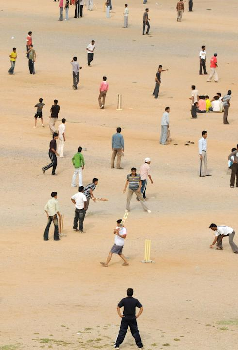 Indian youths play cricket at the NTR gr