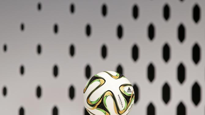 A Brazuca ball, the official match ball for the 2014 World Cup by Adidas, is seen before the company's news conference in Herzogenaurach