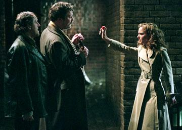 Mark Phoenix as Willy Fingerman, Ian Burfield as Tweed Coat Fingerman and Natalie Portman as Evey in Warner Bros. Pictures' V for Vendetta