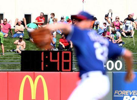 File photo of the detailed view of the pace of play digital pitch clock in the outfield between innings of the game during a spring training baseball game at Surprise Stadium in Surprise