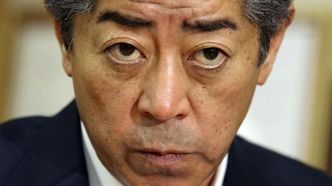 "In this June 30, 2014 photo, Japanese lawmaker and chairman of the ruling Liberal Democratic Party's Research Commission on Security, Takeshi Iwaya listens to a question during an interview in Tokyo. ""In the long run, I think we should put a large security umbrella over the entire Asia-Pacific region, like the one in Europe. That's the direction we seek under the slogan that the Abe administration promotes: proactive contribution to peace based on international cooperation."" Iwaya replied to The Associated Press about where Japan's military is headed and why it is such a sensitive issue. (AP Photo/Koji Sasahara)"