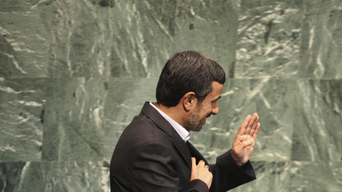 Iranian President Mahmoud Ahmadinejad waves as he approaches the podium during a high level meeting in the United Nations General Assembly at U.N. headquarters Monday, Sept. 24, 2012.  (AP Photo/Seth Wenig)