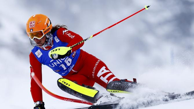 Costazza from Italy clears a gate during the first run of the World Cup Women's Slalom race in Kuehtai ski resort