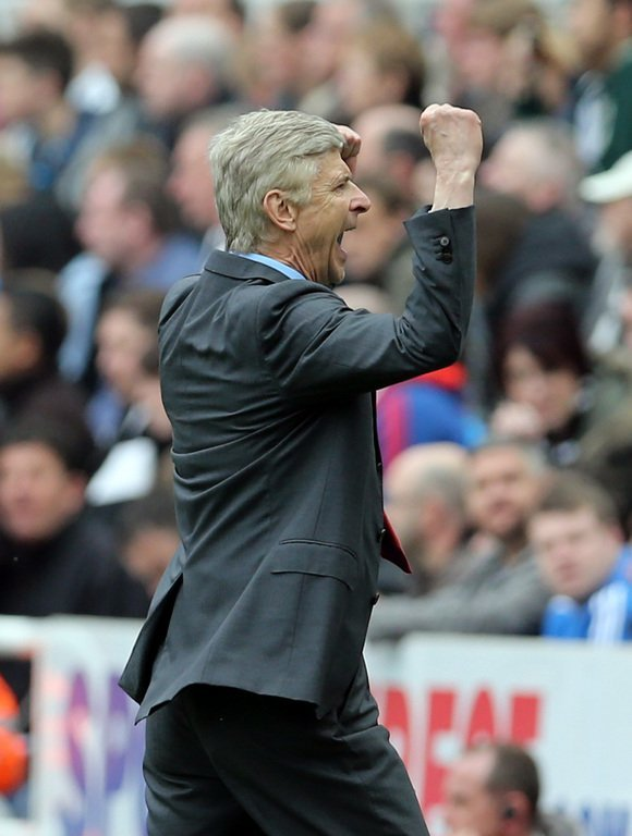 Arsene Wenger celebrates after Arsenal win 1-0 against Newcastle at St James' Park on May 19, 2013