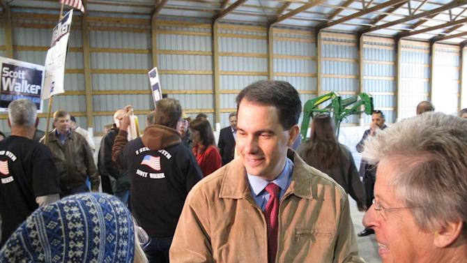 Wisconsin Gov. Scott Walker greets supporters after the first of six campaign stops across the state Tuesday, April 10, 2012, in Dane, Wis. Walker and Lt. Gov. Rebecca Kleefisch spent the day campaigning two months away from the June 5 recall election. (AP Photo/Scott Bauer)