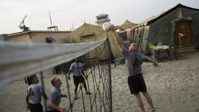 U.S. soldiers play volleyball at forward operating base Fenty in the Nangarhar province of Afghanistan