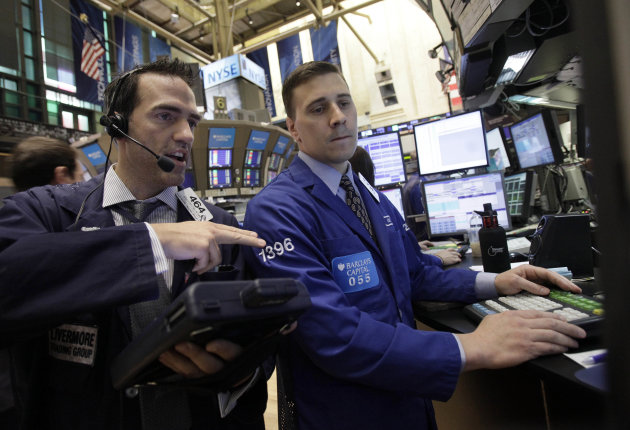 Trader Gregory Rowe, left, and specialist Joseph Mastrolia work on the floor of the New York Stock Exchange Thursday, June 16, 2011. (AP Photo/Richard Drew)